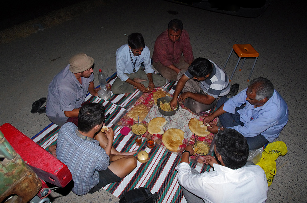 Sharing a meal with Iranian truck drivers in Turkmenistan.